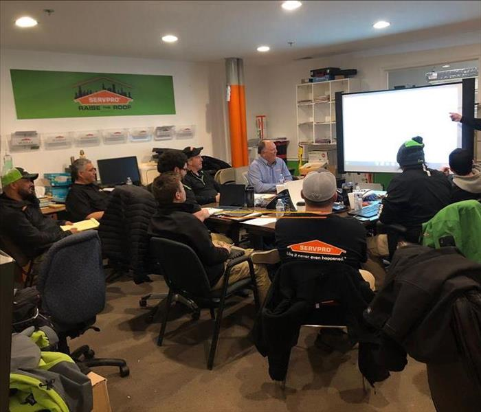 SERVPRO employees sitting in a room.